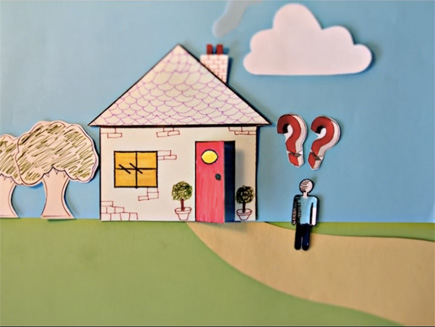 Animation still: brightly coloured cut out paper depicts a boy and a house. The boy has question marks above his head